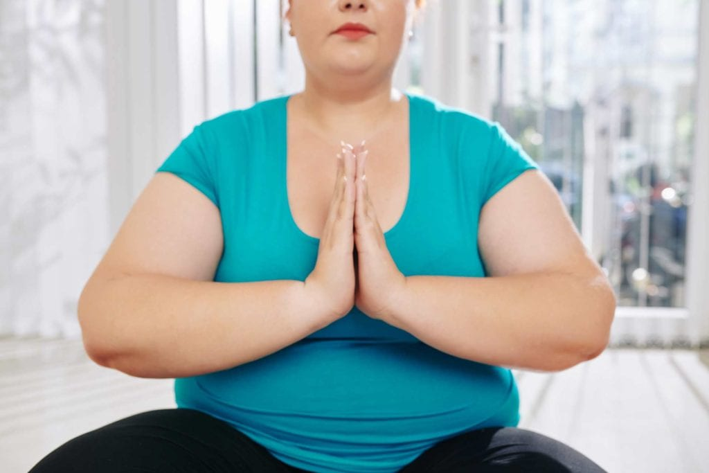 overweight lady meditating