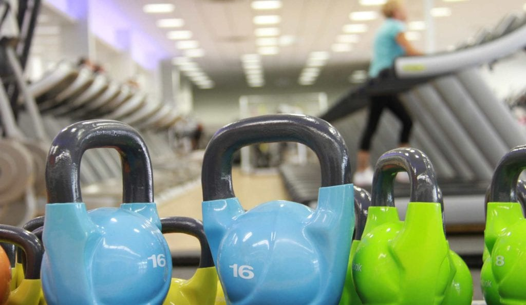 gym weights and blurred background